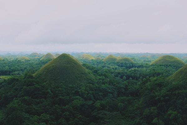The Chocolate Hills are one of many places to visit in the Philippines